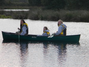 Wetheads in the canoe, heading out to collect ducks from the trap.